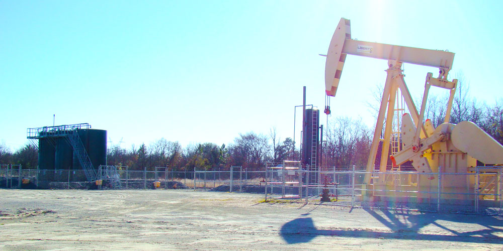 Image of tanks and pump jack from Maximus Operating